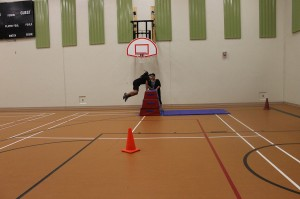 Casey Sappier vaults as she runs through the RCMP PARE Course. Casey clocked the fastest time of all the participants!