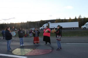 Women Drummers from TFN drum and sing around a Medicine   Circle on the TransCanada Highway on Thursday