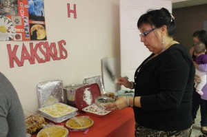 Sharlene Paul blesses the wonderful potluck buffet with a traditional sage smudge.