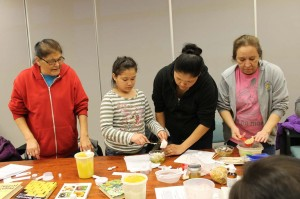 Frances, Azibis, Jennifer and Kim mixing their own unique lotion blends at the Negotkuk Language Initiative Workshop
