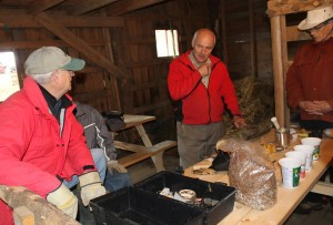 Mycologist David Boyle (centre) lays out the tools and ingredients needed for growing shiitake mushrooms on logs