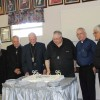 Rejeanne Beaulieu, Father Alfred Irving, Bishop Emeritus Gerard Dionne, Father Gilbert Doddatto, Father Claude Thibodeau and Father Curtis Sappier cut the Anniversary Cake