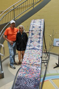 Victor Bear & Iris Nicholas with the beautiful Trails of Hope & Light Wampum Belt at Mah Sos School