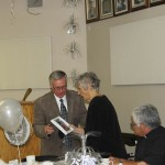 John Lang presents Rejeanne Beaulieu with a photo plaque to commemorate her former position as President of the Parish Council