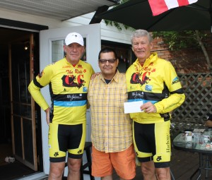 Hugh Fallon, Tim Nicholas & Sid Dickinson with a donation Tim & his  family presented to  the C2C bikers while enjoying lunch at the 878 Bistro