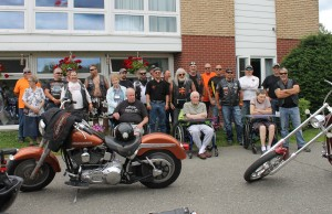 Victoria Glen Manor residents Neil Hamilton, Roland Miller & Val McLean enjoy a visit from Toy Run participants